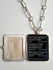 Patricia Sullivan: (detail) Widget Locket. Sterling silver, Katan silk, plexiglas, archival paper, 2012.