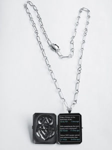 "Patricia Sullivan: ""Widget Locket #3: Homage to Art Nouveau"", chased/repoussé sterling silver, patina, plexiglas, archival paper, hand-fabricated chain/clasp, 21"" x 1.75"" x .25"", 2013."