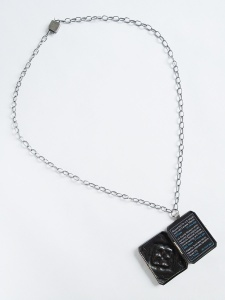 "Patricia Sullivan: ""Widget Locket #4: Homage to Mexico"", chased/repoussé copper, sterling silver, patina, Plexiglas, archival paper, hand-fabricated/oxidized sterling silver chain/clasp, 17"" x 1.75"" x .3125"", 2013. Photo: P. Sullivan"