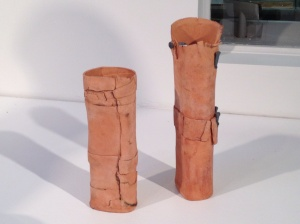 "Risa Hirsch Ehrlich: ""Two Vases Alike"" (installation view). Ceramic, metal elements, 13""x4""x3"", 2011. Photo: P. Sullivan"