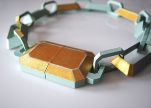 "Rachel Timmins, ""Gem Cut"", 8""x 8""x 1.5"", 3D printed nylon, paint, rare earth magnets, 2013."