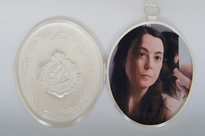 "Patricia Sullivan: ""Widget Locket #5: Homage to Vanity"" (inside detail).  Chased sterling silver, archival paper, Plexiglas, handmade sterling chain/clasp. 19  7/8"" x 2  5/16"" x 5/16"", 2014. Photo: P. Sullivan"