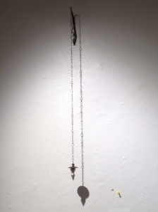 "Ana M. Lopez: ""Plumb Bob: Shelter"" (installation view). Sterling silver, 14K yellow gold, forged steel, 2.75"" x 1.75"" x 29.5"", 2012."