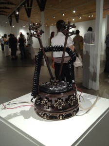 "Becky McDonah, ""Lost Connection: A Reliquary for the Telephone Cord"" (installation view). Copper, sterling, fine silver, pearls, onyx, enamel, found telephone parts, 11"" x 6"" x 6"", 2012."