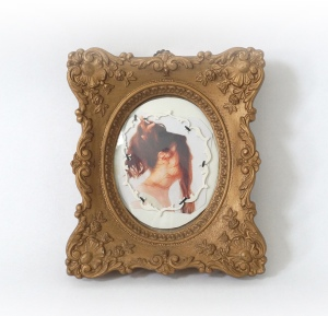 "Patricia Sullivan, ""Cameo Relief of Woman Holding Her Hair."" Vintage painted shadow box frame, vintage glass, brass hardware, digital photo on archival paper, microwaveable soup bowl material, thread. 5 in. L x 4 7/8 in. W x 7/8 in. D, 2015."