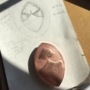 "A work-in-progress (w.i.p.) Instagram photo c. April 2016 of the ""Cityscape Widget"" copper repoussé vessel, with planning drawings done in graphite. Photo: P. Sullivan"